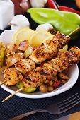 Spicy grilled chicken meat on skewer with vegetables