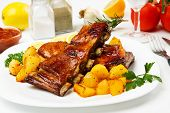 Honey glazed barbecued ribs with baked potato