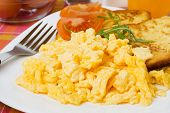 stock photo of scrambled eggs  - Scrambled egg served with french toast and tomato - JPG