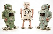 three retro robot toys