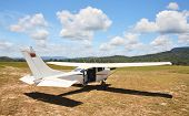 stock photo of cessna  - Cessna plane on the unpaved airfield - JPG