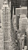 Urban city street aerial view in black and white. New York City Manhattan with skyscrapers, pedestrian and busy traffic.
