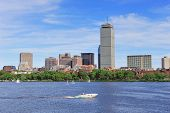 picture of prudential center  - Boston city skyline with Prudential Tower and urban skyscrapers over Charles River with boat - JPG