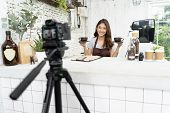 Attractive Young Asian Beautiful Caucasian Barista In Apron Smiling With Recording Video Camera Film poster