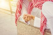 Close Up Of Young Arab Middle Eastern Businessman Arm Wrestling When Friends Meeting poster