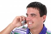 Close-up of attractive Young Man On Cellphone With Smile.  Nineteen years old.
