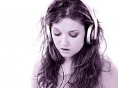 Beautiful Teen Girl with Headphones and Laptop.  Listening and singing to music. Shot in studio over