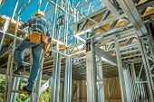 Caucasian Steel Frame Worker. Building Technologies. Construction Site. poster