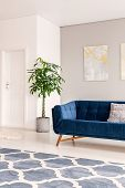 A View At An Inner Door Through A Bright And Minimal Lounge Interior With A Comfortable Dark Blue Se poster