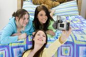 picture of slumber party  - Three teen girls taking group self - JPG