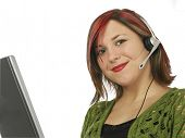 Young woman with computer and headset. Shot in studio over white.