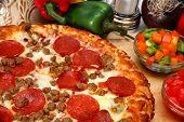 close up of homemade sausage and peperoni pizza