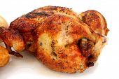 Close up rotisserie chicken over white background.