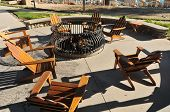 Empty Chairs Around Burning Fire Pit