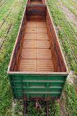 foto of boxcar  - Empty boxcar on the railroad transportation green - JPG