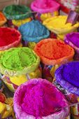 stock photo of haldi  - Piles of colored powder for Indian festival Holi - JPG