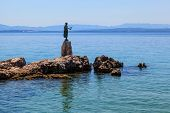 Bronze Sculpture Of Maiden With Seagull On Background A Sea In Opatija, Croatia