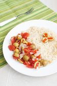 Stuffed olives and tomato salad with couscous