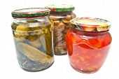 Three Glass Jars With Marinated Vegetables
