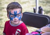 Young Boy With Batman Face Paint