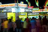 County Fair Patrons Move About Fast Food Vendors