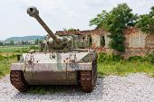 Tank In Front Of Broken House