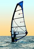 Windsurfer On Waves Of A Sea 1