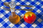 stock photo of cider apples  - cider vinegar with apple on a bavarian desk - JPG