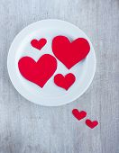 Big And Small Hearts On The White Round Plate