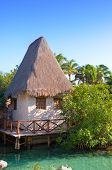 The sea coast with the traditional house in Xcaret park near Cozumel Mexico