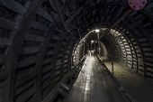 foto of dungeon  - Belt conveyor to transport coal in mining tunnel