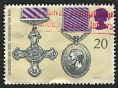 UK - CIRCA 1990: A stamp printed in UK shows image of the Distinguished Flying Cross and Distinguished Flying Medal, circa 1990.