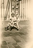 Vintage photo of little girls on tricycle (fifties)