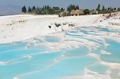 PAMUKKALE, TURKEY - AUGUST 18: Crowds of tourists on travertine terraces in Pamukkale, Turkey on Aug