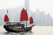 HONG KONG - OCTOBER 8: A Junk ship in Victoria Harbor October 8, 2012 in in Hong Kong, SAR. Junk shi