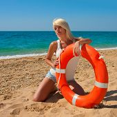 pic of lifeline  - Beautiful slim girl on the beach with a lifeline - JPG