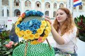 MOSCOW - SEPTEMBER 4: Girl makes bouquets from roses at XIX International Flower Show in Gostinnyj d