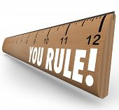 The words You Rule on a ruler to illustrate good or grate grades, review, approval, praise, commenda
