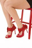Red Shoes And Chair Legs