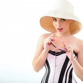 Summer pinup girl, portrait of young happy sexy woman in pin-up style in panama hat with sun glasses