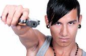 Hispanic Man Pointing Gun At Camera