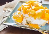 pic of jello  - Decadent cheesecake topped with fresh mango and orange jello with macadamia nut crust - JPG