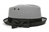 a checkered hat and a black bow tie on a white background