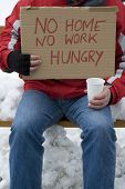 picture of homeless  - Homeless unemployed hungry Man begs for money sedentarily on a park bench - JPG