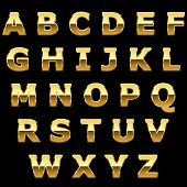 Golden metallic shiny letters isolated on black background.
