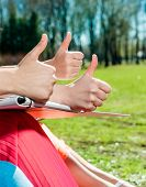 Students With Thumbs Up Outdoors