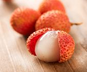 Lychee on a wooden table. Lichi Closeup. Selective focus.