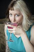 Beautiful Young Woman Drinking Pink Martini