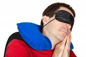 foto of blindfolded man  - man with travel Neck Pillow and Sleeping mask sleep in a armchair - JPG