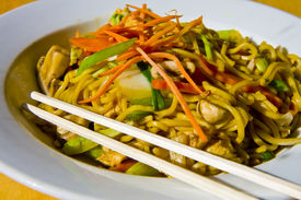 stock photo of lo mein  - Fresh colorful lo mein in a white bowl with chopsticks